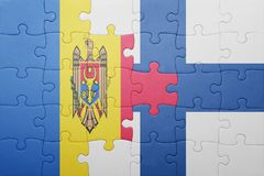 Puzzle with the national flag of moldova and finland. Concept Royalty Free Stock Photography