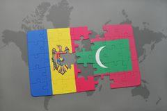 Puzzle with the national flag of moldova and maldives on a world map. Background. 3D illustration Royalty Free Stock Images