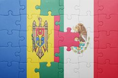 Puzzle with the national flag of moldova and mexico. Concept royalty free stock photos
