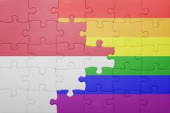 Puzzle with the national flag of monaco and gay flag Stock Images