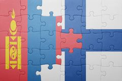 Puzzle with the national flag of mongolia and finland. Concept Royalty Free Stock Photo