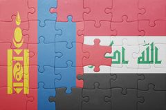 Puzzle with the national flag of mongolia and iraq Stock Photography