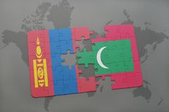 Puzzle with the national flag of mongolia and maldives on a world map background. 3D illustration Royalty Free Stock Photography