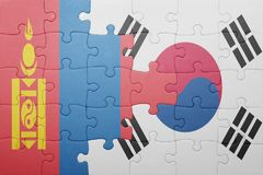 Puzzle with the national flag of mongolia and south korea. Concept royalty free stock photo