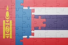 Puzzle with the national flag of mongolia and thailand Stock Photos