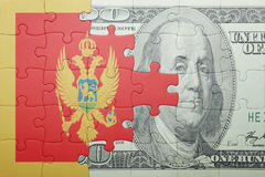 Puzzle with the national flag of montenegro and dollar banknote. Concept Stock Images