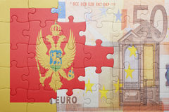 Puzzle with the national flag of montenegro and euro banknote Stock Photo