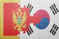 Puzzle with the national flag of montenegro and south korea. Concept stock photo