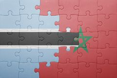 Puzzle with the national flag of morocco and botswana . Royalty Free Stock Photos