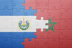 puzzle with the national flag of morocco and el salvador . Stock Photography