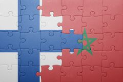 Puzzle with the national flag of morocco and finland . Royalty Free Stock Photo
