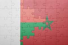 Puzzle with the national flag of morocco and madagascar . Concept Stock Images