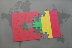 Puzzle with the national flag of morocco and mali on a world map. Background. 3D illustration stock photo