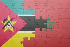 Puzzle with the national flag of morocco and mozambique . Royalty Free Stock Photo