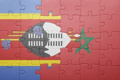 Puzzle with the national flag of morocco and swaziland . Stock Image