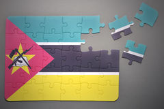 Puzzle with the national flag of mozambique Stock Images