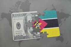 Puzzle with the national flag of mozambique and dollar banknote on a world map background. 3D illustration Stock Photo