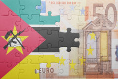 Puzzle with the national flag of mozambique and euro banknote Stock Photography
