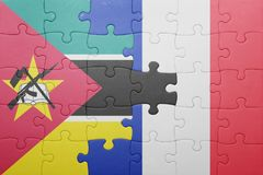 Puzzle with the national flag of mozambique and france. Concept Royalty Free Stock Image