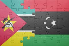 Puzzle with the national flag of mozambique and libya Stock Photo