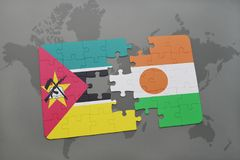 Puzzle with the national flag of mozambique and niger on a world map. Background. 3D illustration Royalty Free Stock Photo
