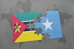 Puzzle with the national flag of mozambique and somalia on a world map Royalty Free Stock Photo
