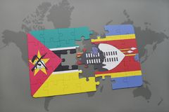 Puzzle with the national flag of mozambique and swaziland on a world map Royalty Free Stock Image