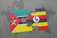 Puzzle with the national flag of mozambique and uganda on a world map. Background. 3D illustration Stock Photo