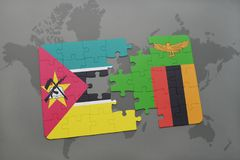 Puzzle with the national flag of mozambique and zambia on a world map Stock Image