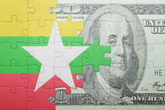 Puzzle with the national flag of myanmar and dollar banknote Royalty Free Stock Photography