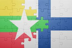 Puzzle with the national flag of myanmar and finland Stock Photo