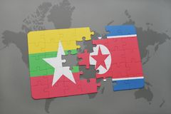 Puzzle with the national flag of myanmar and north korea on a world map background. 3D illustration royalty free stock photos