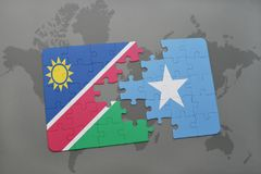 Puzzle with the national flag of namibia and somalia on a world map. Background. 3D illustration stock photos