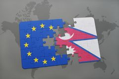 Puzzle with the national flag of nepal and european union on a world map Stock Photo