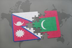 Puzzle with the national flag of nepal and maldives on a world map background. 3D illustration Stock Photography