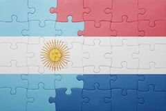 Puzzle with the national flag of netherlands and argentina Stock Images