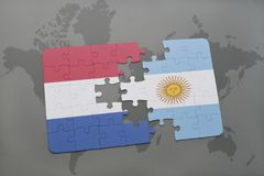Puzzle with the national flag of netherlands and argentina on a world map background. Royalty Free Stock Photography