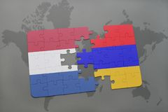 Puzzle with the national flag of netherlands and armenia on a world map background. Stock Images