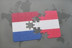 Puzzle with the national flag of netherlands and austria on a world map background. 3D illustration Stock Images