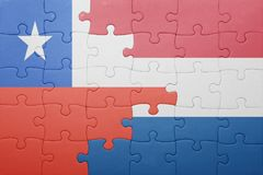 Puzzle with the national flag of netherlands and chile Royalty Free Stock Photo