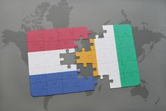 Puzzle with the national flag of netherlands and cote divoire on a world map background. 3D illustration Royalty Free Stock Image