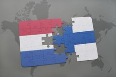 Puzzle with the national flag of netherlands and finland on a world map background. Stock Image