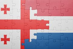 Puzzle with the national flag of netherlands and georgia Stock Photo