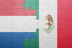 Puzzle with the national flag of netherlands and mexico. Concept stock photo