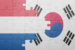 Puzzle with the national flag of netherlands and south korea. Concept stock photography