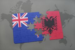 Puzzle with the national flag of new zealand and albania on a world map background Royalty Free Stock Image