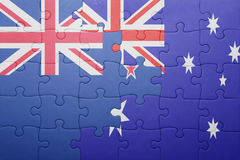 Puzzle with the national flag of new zealand and  australia. Concept Royalty Free Stock Photography