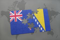 Puzzle with the national flag of new zealand and bosnia and herzegovina on a world map background Royalty Free Stock Images