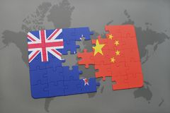 Puzzle with the national flag of new zealand and china on a world map background. 3D illustration. Puzzle with the national flag of new zealand and china on a Stock Photo
