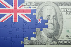 Puzzle with the national flag of new zealand and dollar banknote Royalty Free Stock Image